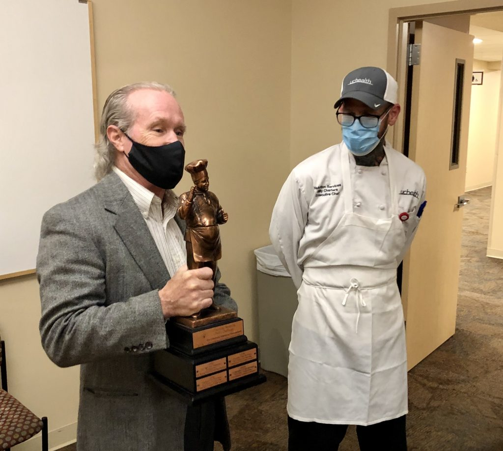 Children's Treehouse Foundation director presents trophy to Executive Chef Charters