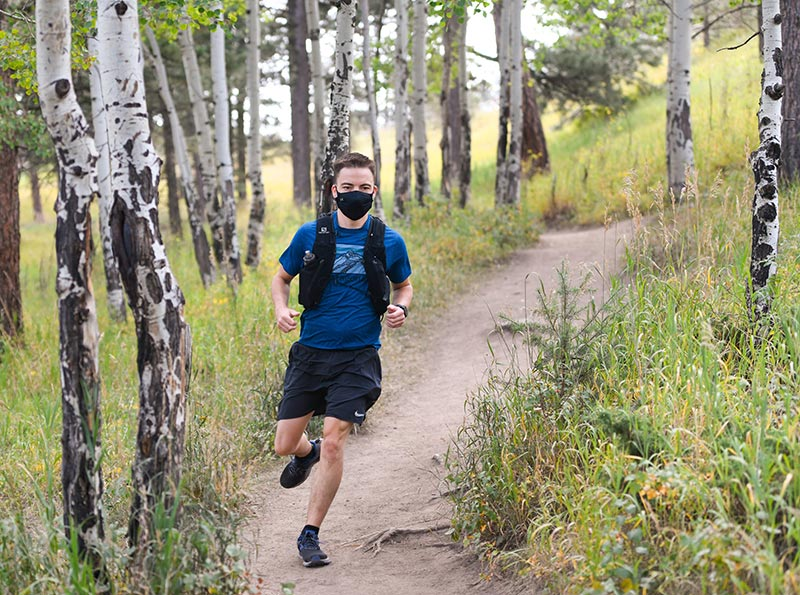 Matt Johnston learned as a young adult that he had a congenital heart defect and took up running. Here, he runs through an aspen grove.