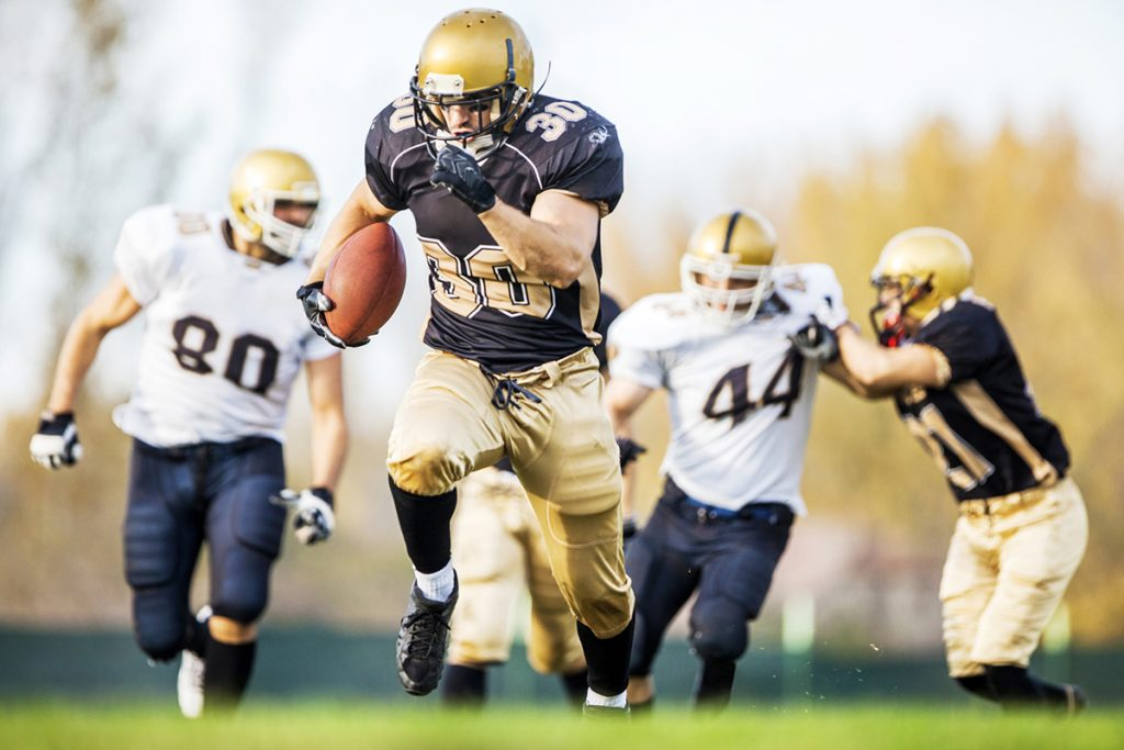 Football players are returning to sport, following successful injury recovery.