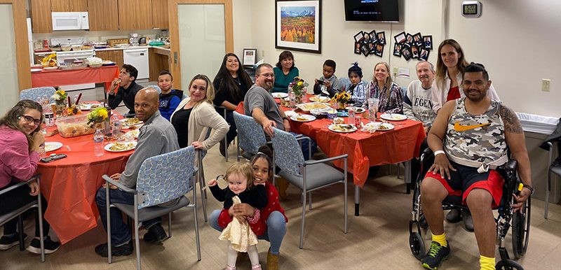 family enjoys thanksgiving feast in the hospital's rehab unit.