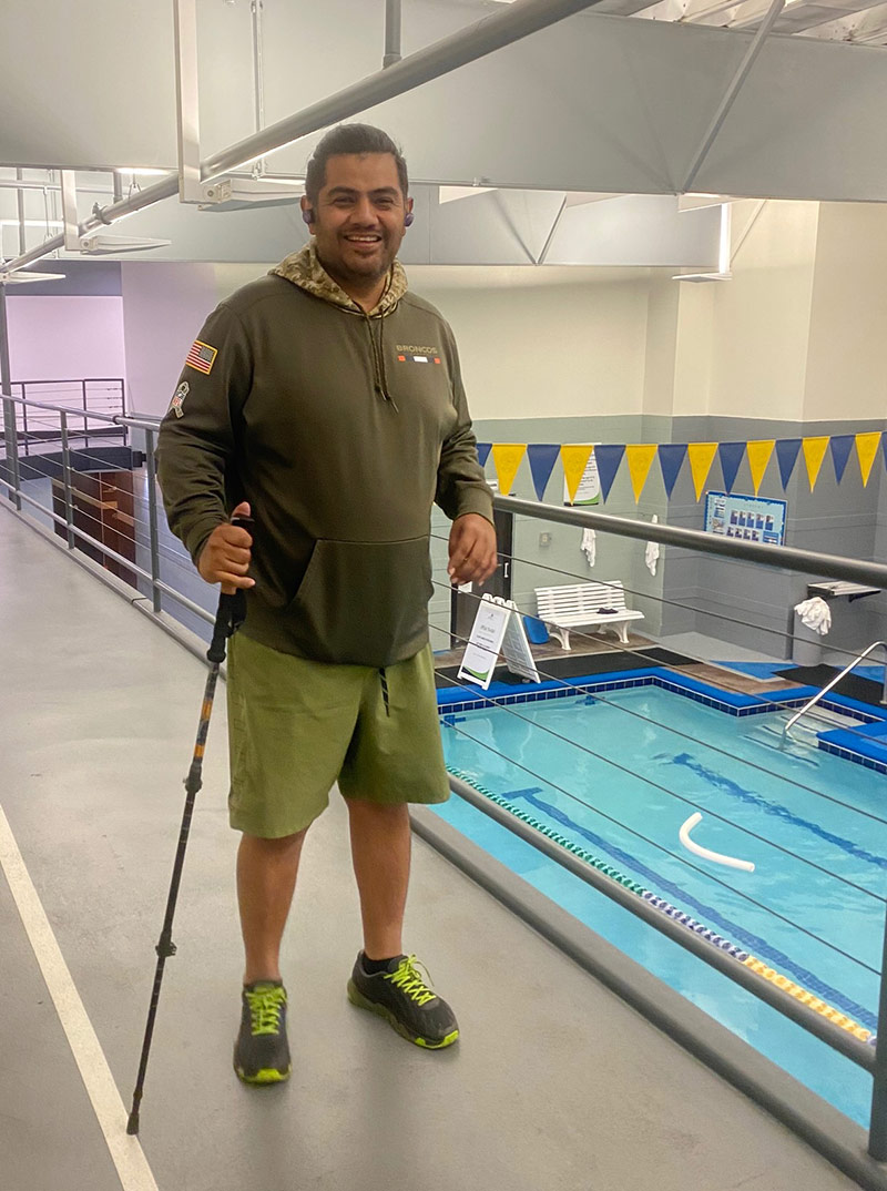 Edgar using the walking track above a pool after his stroke