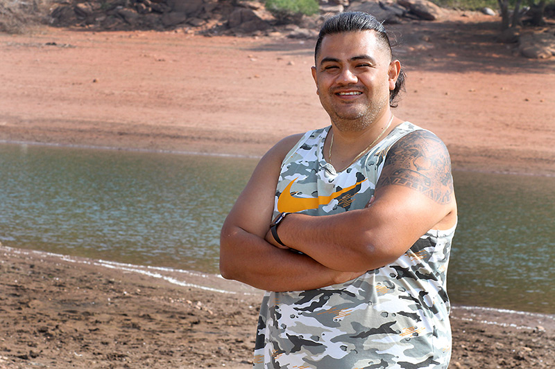 after recovering from a stroke, Edgar stands by a lake during his camping trip.