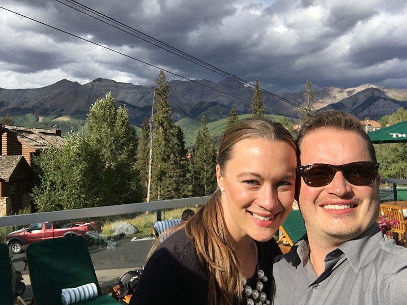 selfie of Justin and Amanda in the mountains, Jeff suffers from FSHD.
