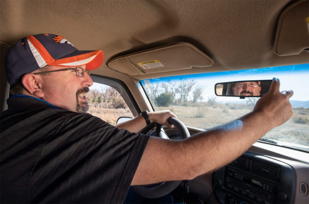 Clay Phillips behind the wheel of his truck after getting relief from epileptic seizures.