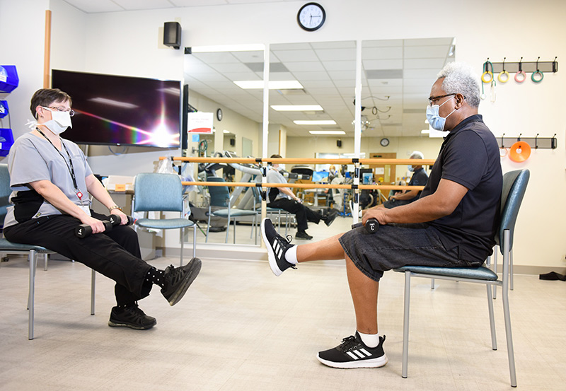 Clarence Troutman is a COVID-19 'long-hauler,' as people dealing with long-term symptoms of COVID-19 describe themselves. Here he works out at a special rehabilitation clinic.
