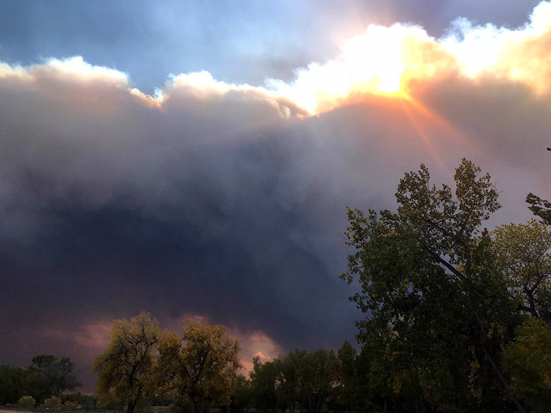 coping with anxiety is hard when it's caused by wildfires as seen in this photo of plumes of smoke over the foothills near Laporte, Colorado