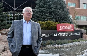 Dr. Gary Luckasen stands in front of UCHealth Medical Center of the Rockies in Loveland, Colorado.