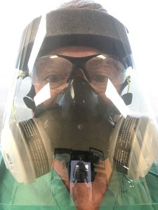 Dr. Richard Zane wearing a respirator mask. A fall COVID-19 spike in Colorado is causing a surge in patients who need hospital care.