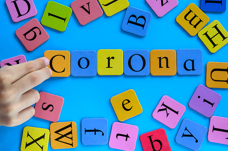 scrabble pieces spelling out corona for this story about coronavirus A to Z.