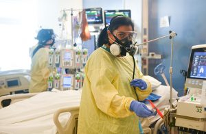 COVID-19 in Colorado continues to get worse. Here Dr. Abbey Lara works in an ICU room with two patients.