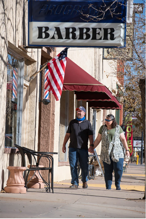 Clay Phillips and his wife, Diana, walk along Main Street in Florence, Colorado.