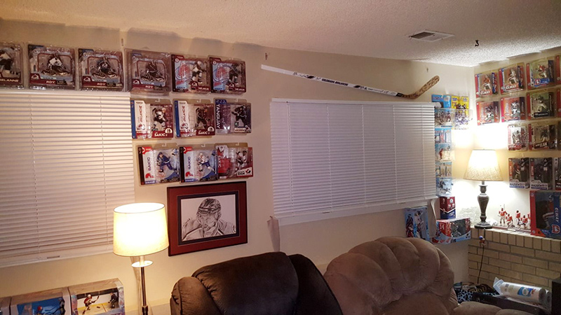 Derek, who is getting immunotherapy for small cell lung cancer, man cave with all his sports memorabilia including a Avs hockey stick he recently got from his oncologist.