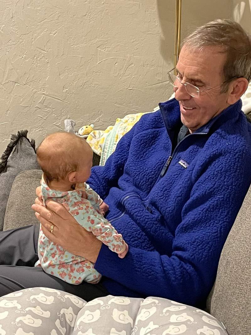 Dr. Michael Leonard, a grateful patient, with his grandchild.
