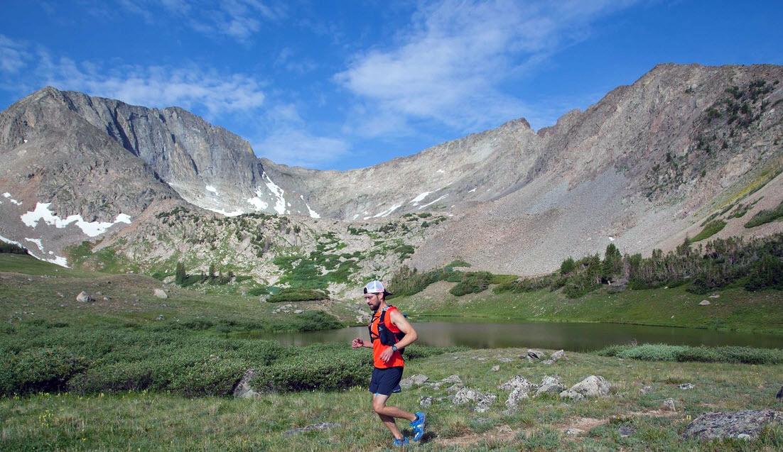A man runs in the mountains.