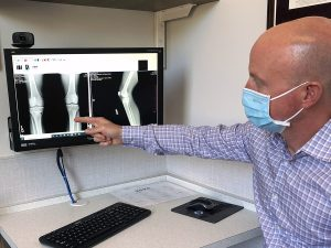 A physician explains a patient's x-rays.
