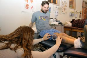 A patient works with a physical therapist following an osteotomy for ACL injuries.