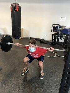 A man lifts weights.