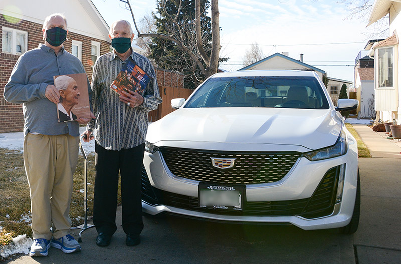 coronavirus vaccines for older adults - Jerry Flack, left, and George Summers, pose with their new car. They are excited to take a roadtrip to Santa Fe.
