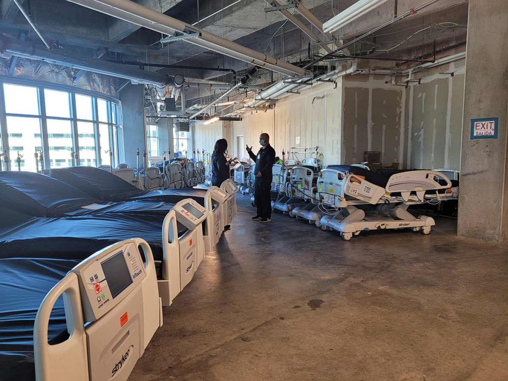 Additional beds need to accomodate a surge in COVID-19 patients are in a warehouse at Memorial Hospital Central.
