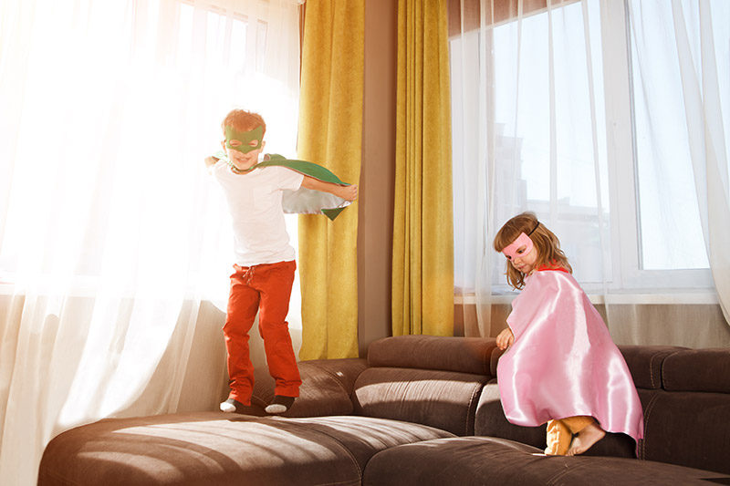 hyperactive children in the home, jumping on the furniture