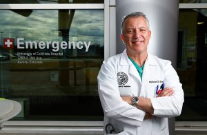 Why COVID-19 vaccines are safe. Dr. Richard Zane smiles outsie the Emergency Department at UCHealth University of Colorado Hospital