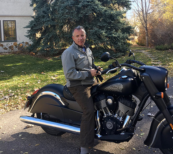 Dr. Richard Zane is confident that vaccines for COVID-19 are safe. He looks forward to a time when the pandemic is over and he has time to ride his motorcycle again.