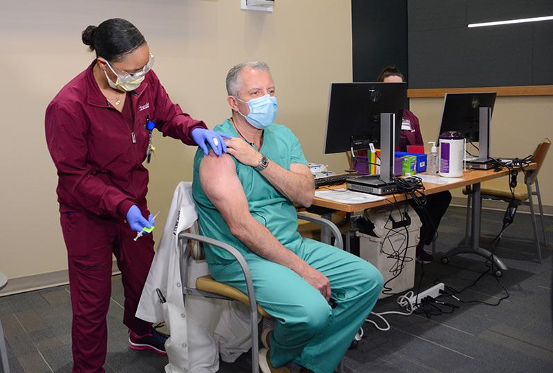 Dr. Richard Zane receives his COVID-19 vaccine.