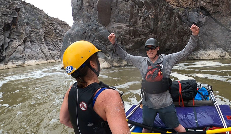 Garry Keller cheers after his family make it safely through Skull Rapid on the Westwater section of the Colorado River in July 2020. Garry was diagnosed with mucosal melanoma in April 2016 and enrolled in several clinical trials. He's had no cancer detected in the past two years. Photo courtesy of Garry Keller.
