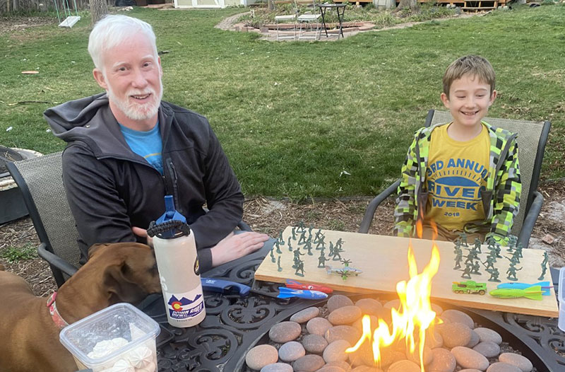 """Garry Keller enjoys time with his son, Boden, in their backyard. Boden thinks his dad is a """"superhero"""" not only because he fought off a rare form of melanoma, but also because that battle left him with white hair. Photo courtesy of Garry Keller."""