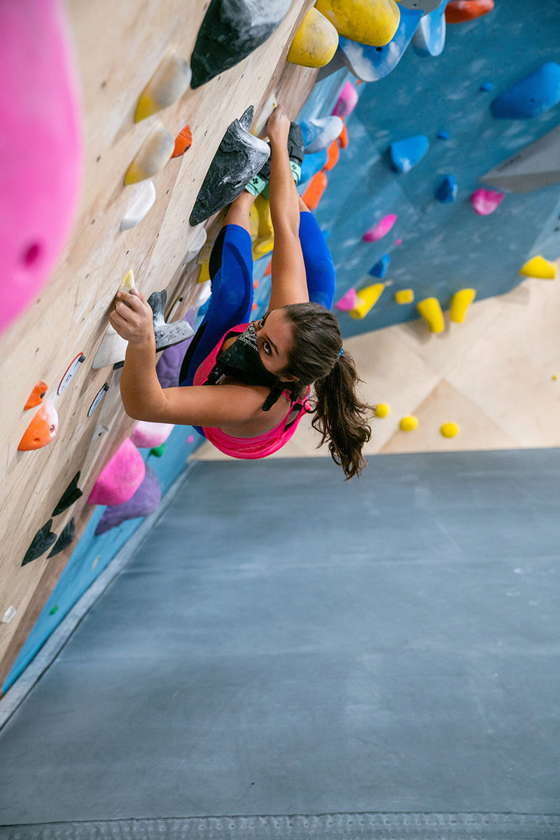 With her MALS successfully treated, Anna went out for and made the CU Boulder Climbing Team. Here she practices at G1 Climbing and Fitness in Broomfield. Photo courtesy of Anna Bajaj.