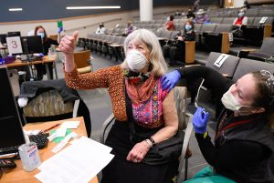 older adults are getting their coronavirus vaccines now. Joanna Moldow gives a thumbs up.