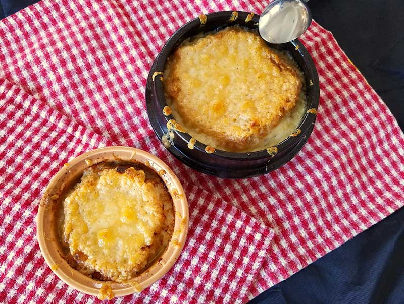 You may use various sized crocks in which to cook and serve French onion soup. But first learn how to cut an onion to keep the tears away. Photo courtesy of Bill St. John.