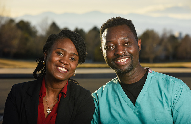 Drs. Cynthia and Kweku Hazel are eager to promote vaccine safety among Black people and other people of color. Here, they pose in a park with mountain views in the background.