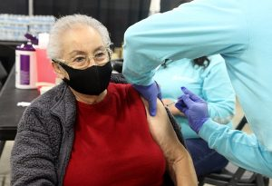 Marina Lopez, 85, part of the Hispanic community in Evans, Colorado, get's her COVID-19 vaccine during a vaccination clinic held by UCHealth and Aspen Community Health in Greeley.