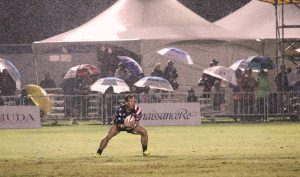 Jonathan Gray plays in the rain, supported by the left knee that Dr. Jason Dragoo repaired with surgery stem cells transplanted from Gray's stomach. Photo courtesy of Jonathan Gray.
