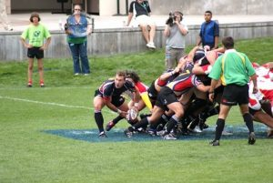 Jonathan Gray, far left, emerges from scrum on the rugby field. Photo courtesy of Jonathan Gray.