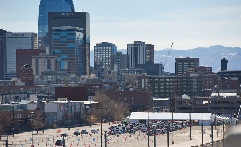 The view of the mass vaccination event with downtown Denver and the mountains in the background.