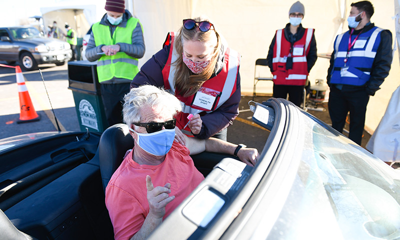 John Herrick, a retired lawyer and law professor, arrived for his vaccine in a convertible.