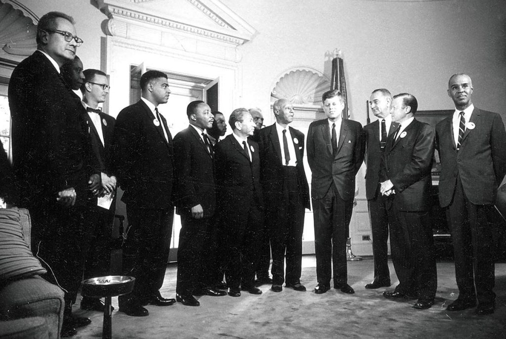 A photo of President John F. Kennedy with Martin Luther King, Jr.