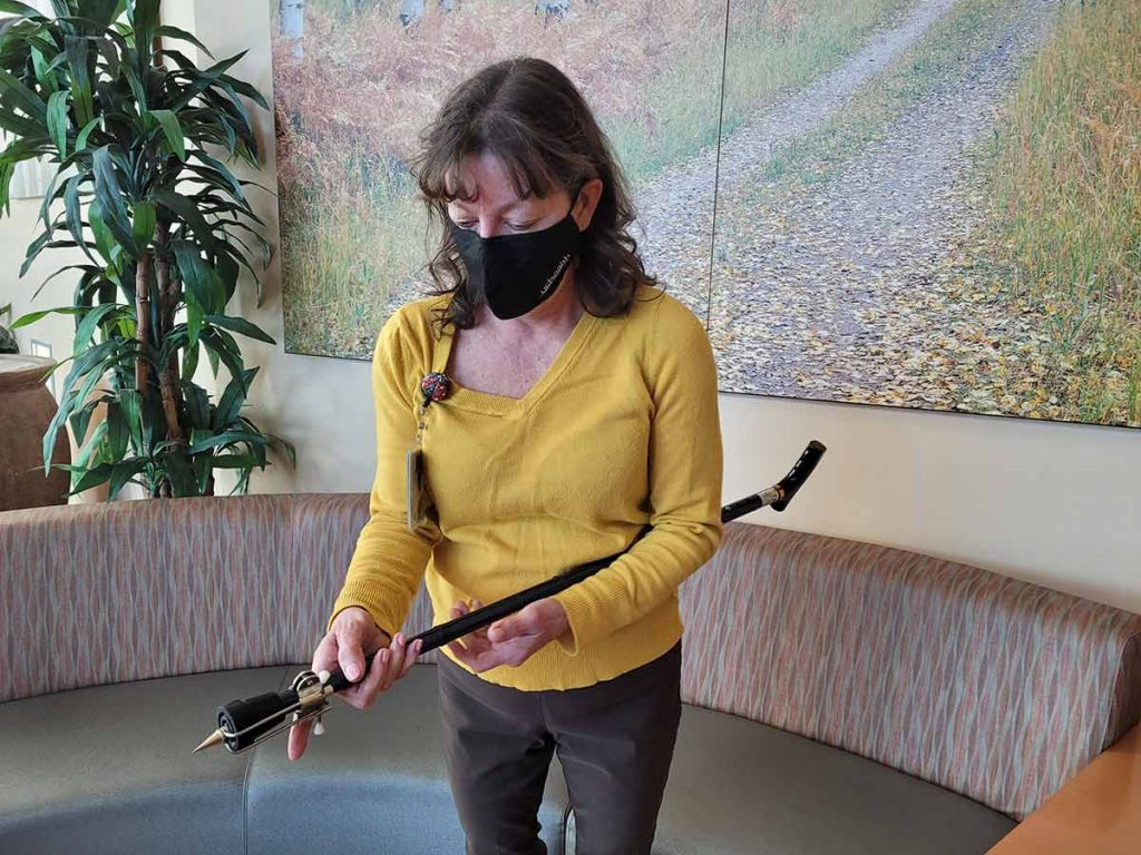 UCHealth Injury Prevention Specialist Lori Morgan demonstrates how attaching an ice tip to a cane can provide additional safety when walking in snow or ice.