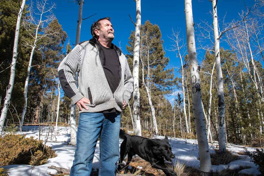 CharlieCHambers looks to the blue sky and aspen trees as he tells his COVID-19 story.