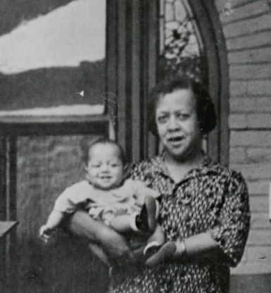 Dr. Justina Ford holding a baby