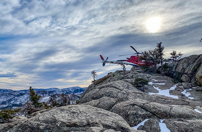 LifeLine medical helicopter atop of Greyrock mountain summit during the hiker rescue on Jan. 7, 2021.