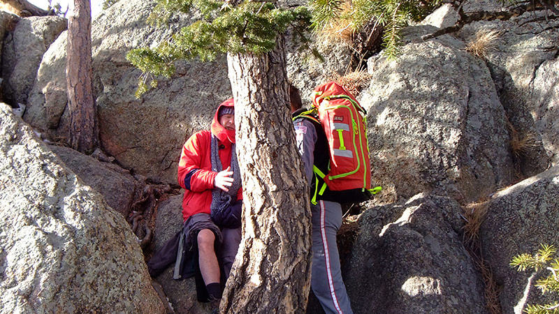 LifeLine crew member, right, helps Phil Sheridan atop of Greyrock mountain during a medical rescue on Jan. 7, 2021.