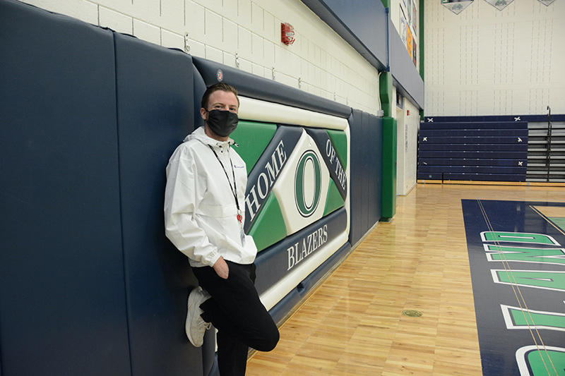 UCHealth athletic trainer, Kyle Thorson, poses in one of the gyms at Overland High School.