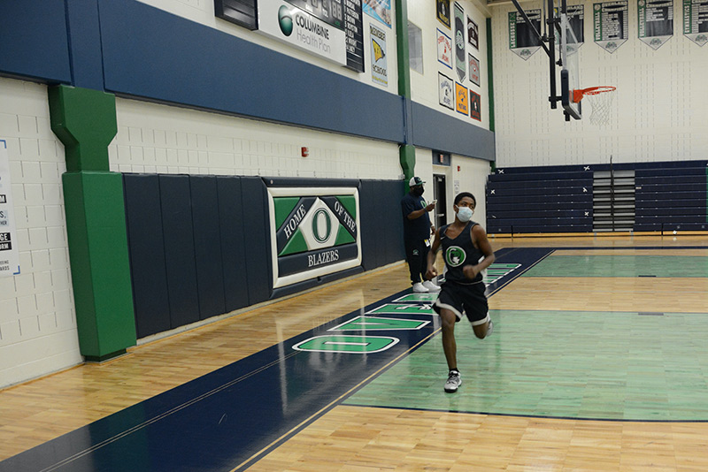 UCHealth athletic trainers are working in schools now. Here, student, Talil Seals-Fisher, runs during basketball practice.