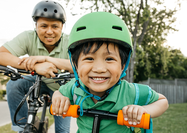 Denver parks. Aurora reservoir has a great bike trail around it. Spring is a great time for cycling. Here a father and his young son ride bikes. Photo: Getty Images.