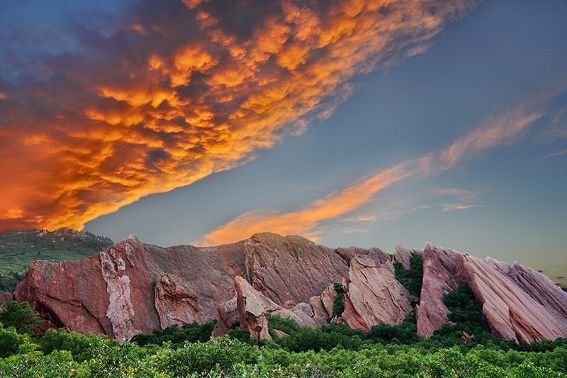 Among the great parks in Denver's backyard is Roxborough, southwest of Denver. It's a great place to hike. Here we see and orange sunset over red rocks that jut up from the ground. Photo: Getty Images.