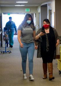 Hernandez and daughter Esmeralda demonstrate the hospitals wayfinding app feature in the halls of UCH.