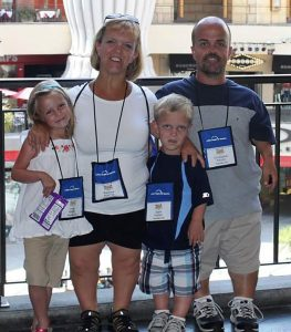 Barb Kotzian with her husband and children.